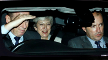 Theresa May spotted leaving Parliament looking 'smug' after Boris Johnson loses crucial Brexit vote