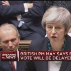 British Prime Minister Theresa May postpones vote on Brex...