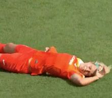 Houston Dash's Rachel Daly collapses on the pitch during closing seconds of match