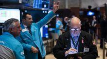 Wall Street, freinée par FedEx, termine près de l'équilibre