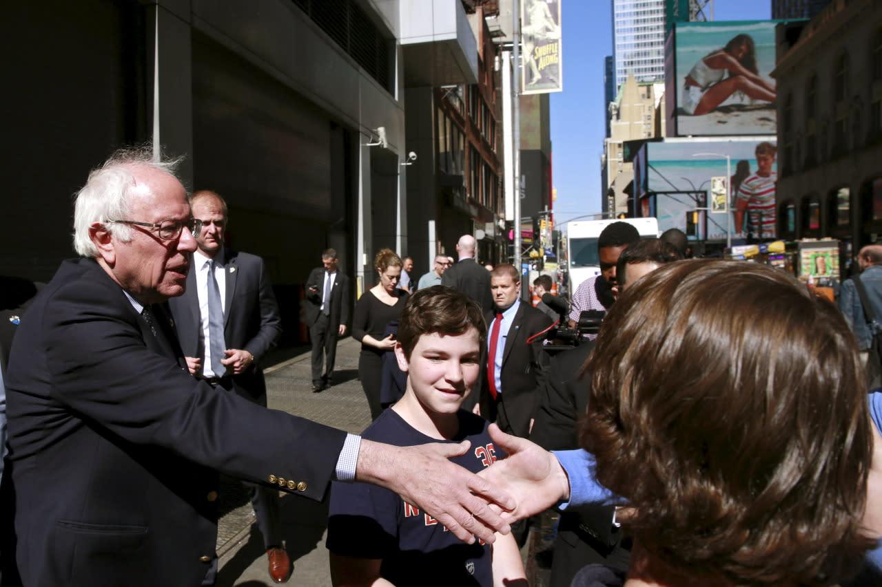<p>Bernie Sanders gets acquainted with pedestrians in Times Square. <i>(Photo: Lucas Jackson/Reuters)</i></p>
