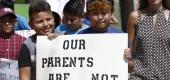 In this Aug. 11, 2019, photo, children of mainly Latino immigrant parents hold signs in support. (AP)