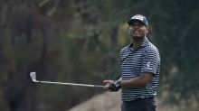 Sebastian Munoz leads, Tiger Woods stumbles at Zozo Championship