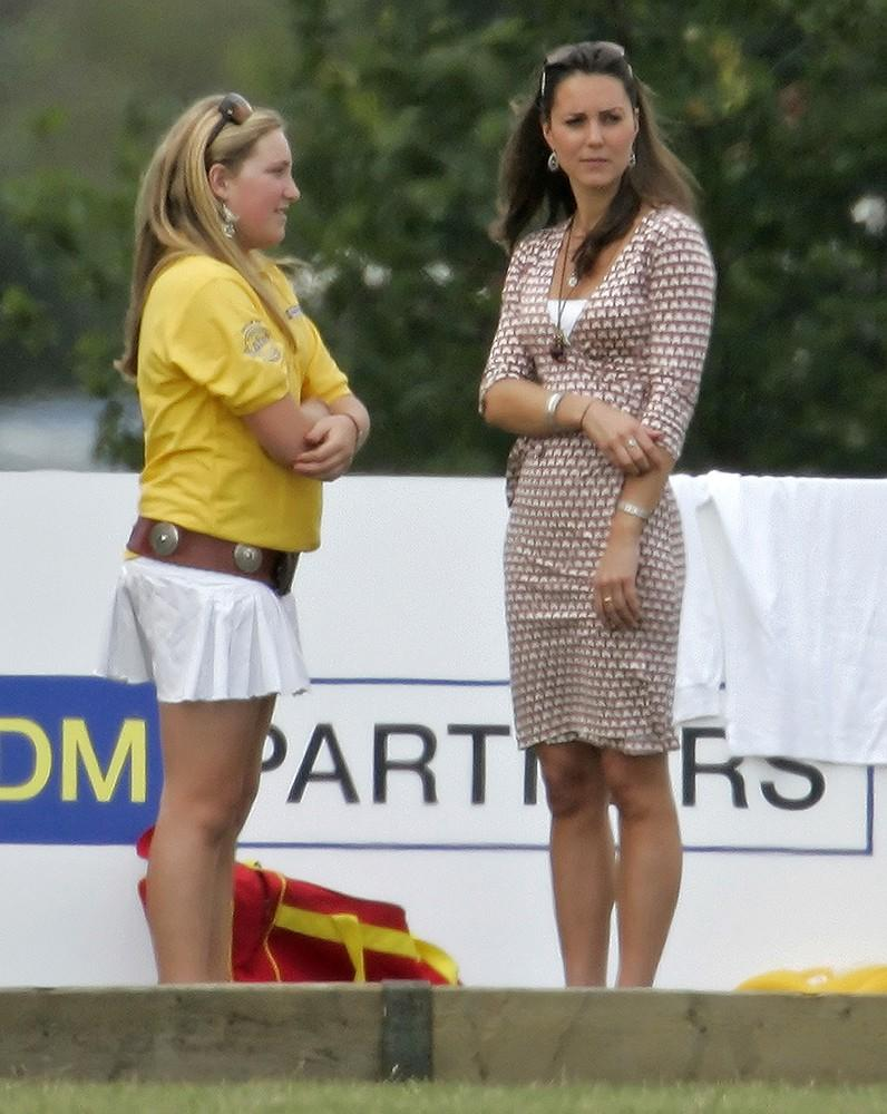 Kate wore one of her favorite silhouettes, a simple wrap dress, for a Polo match.