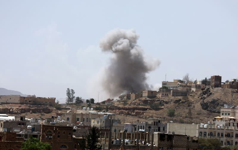 Dust rises from the site of a Saudi-led air strike in Sanaa