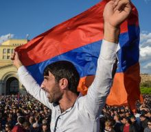 Armenia celebrates as veteran leader quits amid protests