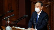 Japan PM vows to press ahead with Olympics despite virus surge