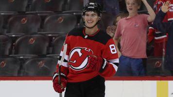 Devils' Hughes nets two goals, game-winner in preseason debut