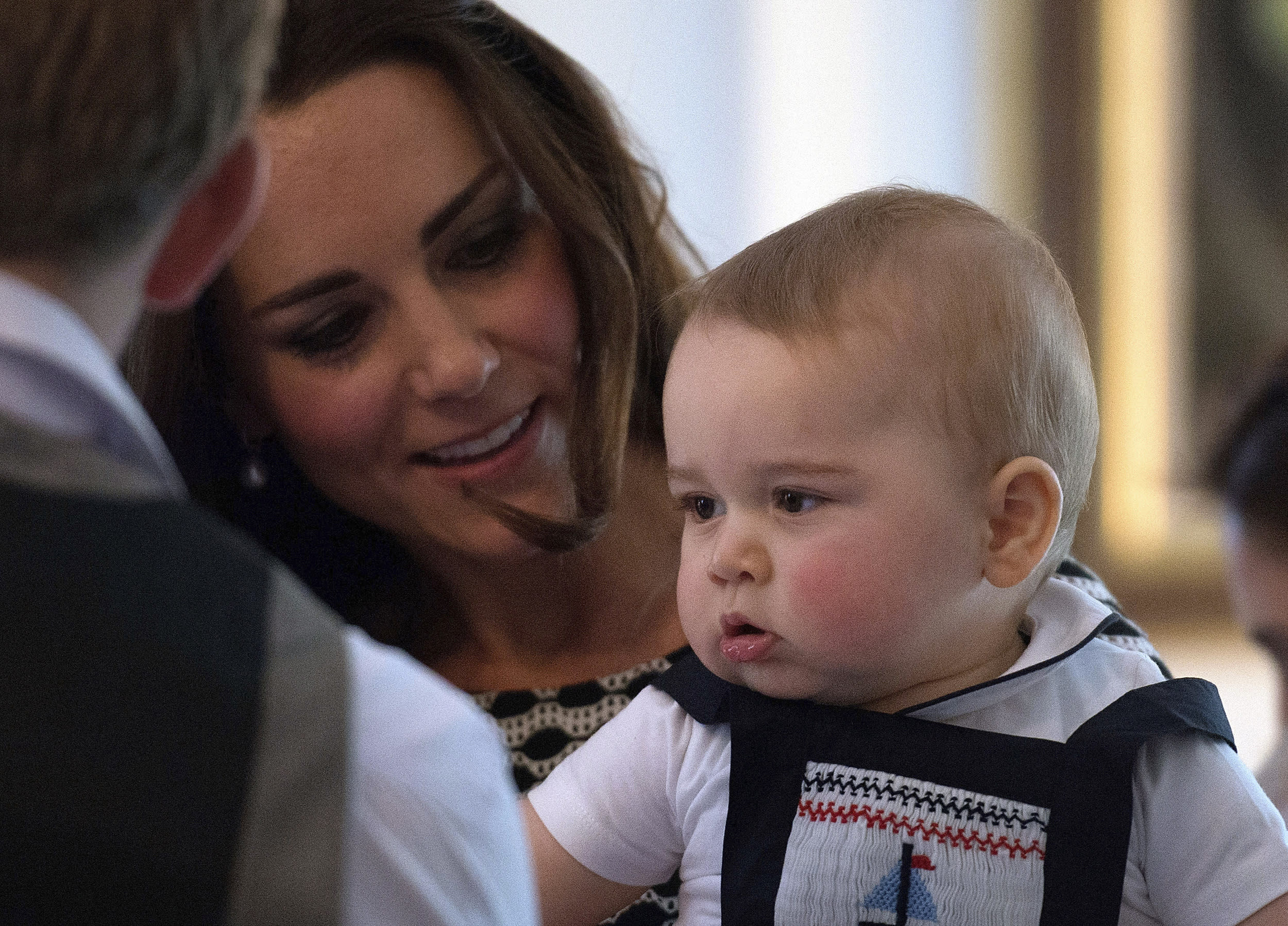 Catherine, Duchess of Cambridge, holds her son Prince George during a Plunket nurse and parents' group event at Government House in Wellington April 9, 2014. Plunket is a national not-for-profit organisation that provides care for children and families in New Zealand. Britain's Prince William and his wife Kate are undertaking a 19-day official visit to New Zealand and Australia with their son George.    REUTERS/Marty Melville/Pool    (NEW ZEALAND - Tags: ROYALS ENTERTAINMENT)