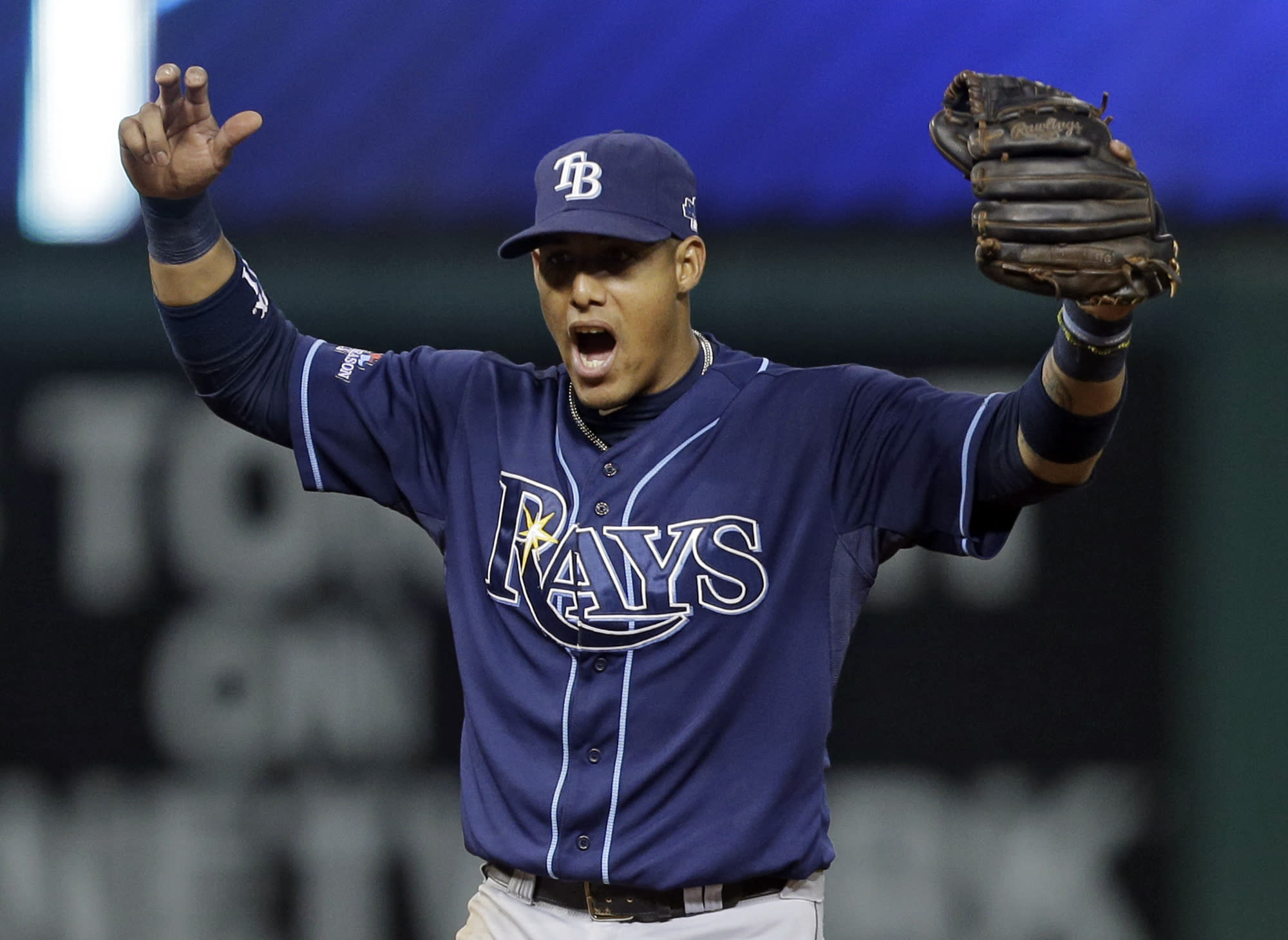 Tampa Bay Rays shortstop Yunel Escobar celebrates after completing a bases-loaded double play against the Cleveland Indians to end the fourth inning in the AL wild-card baseball game Wednesday, Oct. 2, 2013, in Cleveland. (AP Photo/Tony Dejak)