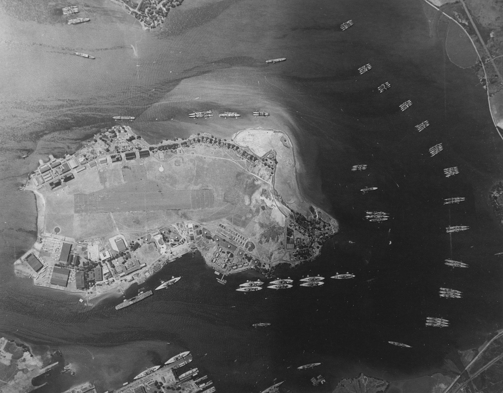 <p>An aerial photograph taken on May 3, 1940, the year before the Japanese raid, shows the East Loch and the the Fleet Air Base on Ford Island in Pearl Harbor. Visible are the carrier Yorktown, 10 battleships, 17 cruisers, two light cruisers and over 30 destroyers. (U.S. Navy/National Archives/Handout via Reuters) </p>