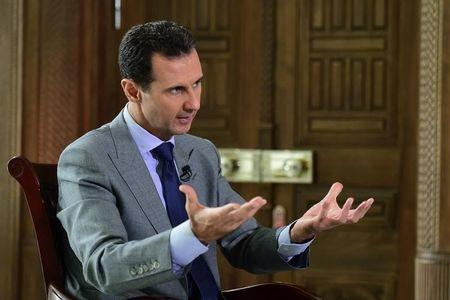 Syria's President Bashar al-Assad speaks during an interview with Russian tabloid Komsomolskaya Pravda