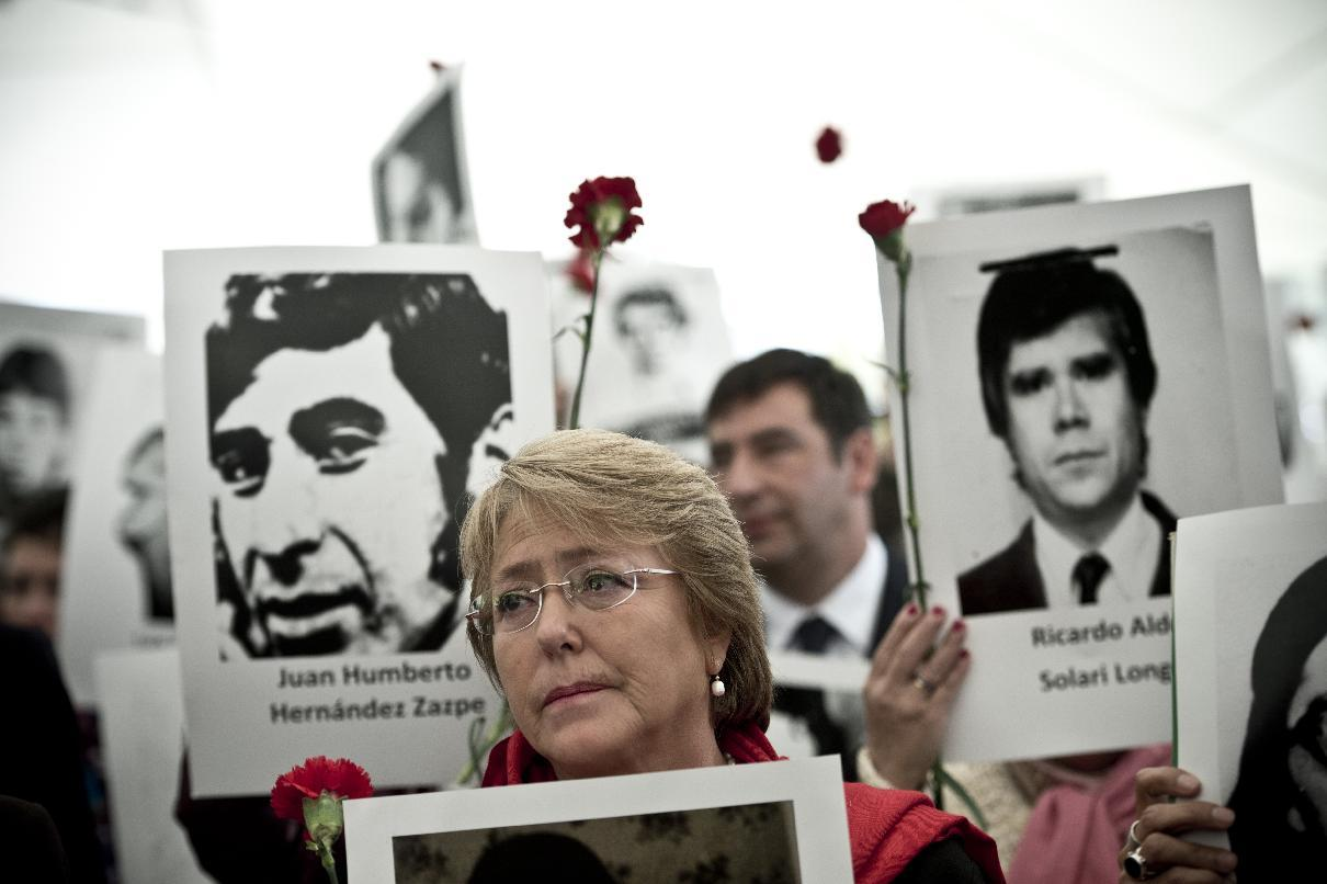 Chilean president Michelle Bachelet participates in a ceremony in Villa Grimaldi, which was used as a detention and torture center during the dictatorship of Augusto Pinochet, in Santiago, on September 10, 2013 (AFP Photo/Martin Bernetti)