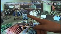'Shoplifter' caught on camera stuffing jackets down his trousers