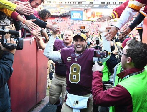Nov 13, 2016; Landover, MD, USA; Washington Redskins quarterback Kirk Cousins (8) is congratulated by fans after the game against the Minnesota Vikings at FedEx Field. The Washington Redskins won 26 - 20. Mandatory Credit: Brad Mills-USA TODAY Sports