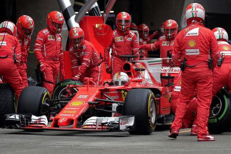 Ferrari's German driver Sebastian Vettel drives his car into the pit lane during the Formula One Chinese Grand Prix in Shanghai