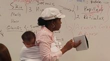 Professor holds baby during 3-hour class after student couldn't find a babysitter