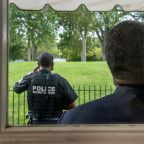 AP sources: Man shot near White House had shouted threats