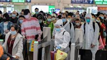 Photos show thousands packing into cars, planes, and trains in a rush to get out of Wuhan as China lifts the coronavirus lockdown