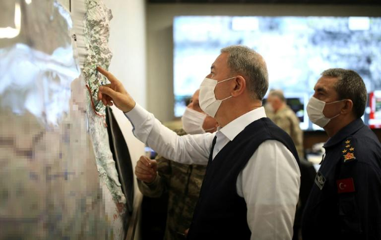 Turkish Defence Minister Hulusi Akar -- photographed in June 2020 -- studies a map at the start of Ankara's latest military operation against the PKK in Iraq