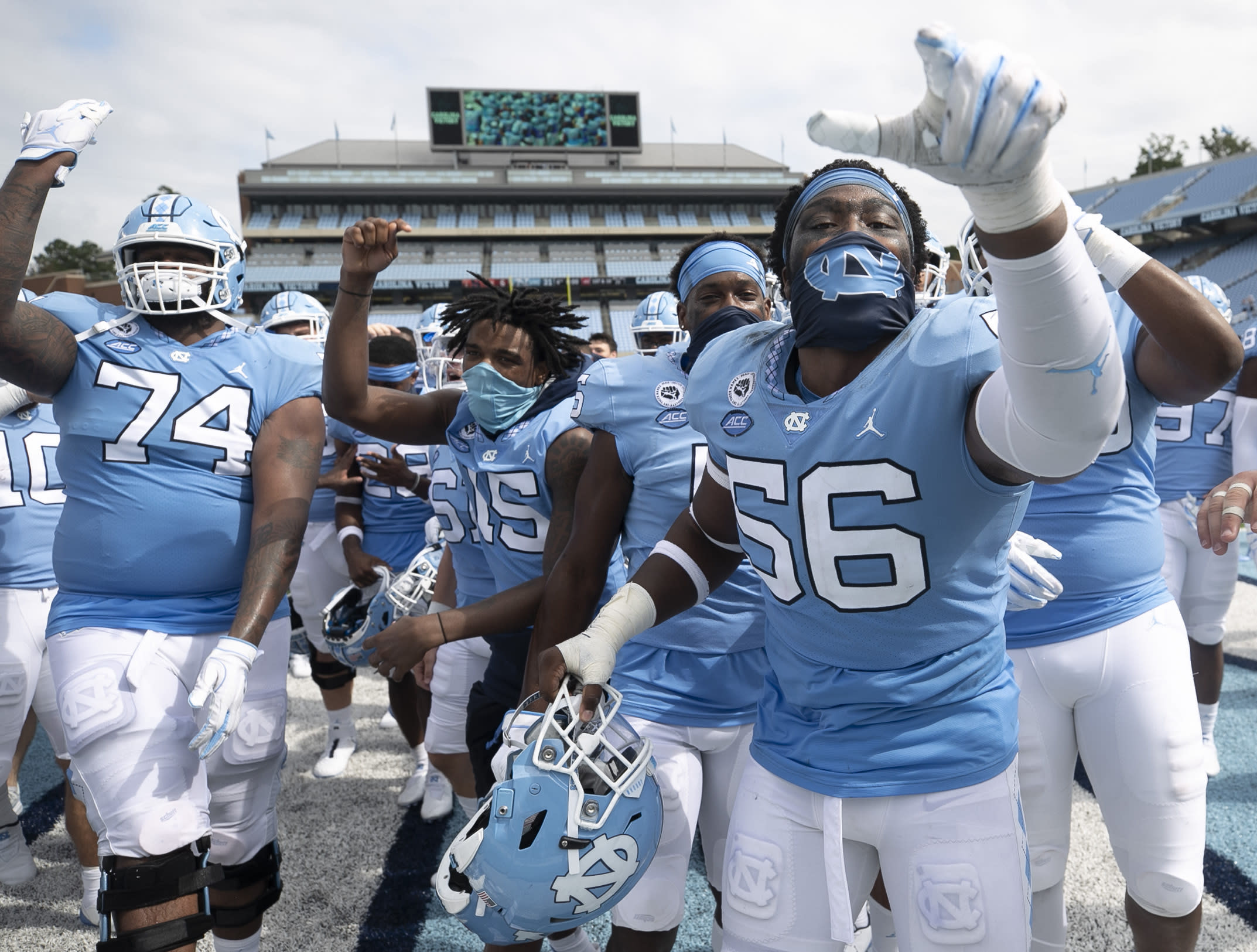 North Carolina's Tomari Fox (56) and his teammates celebrate their victory over Syracuse on Saturday, Sept. 12, 2020, in Chapel Hill, N.C.(Robert Willett/The News & Observer via AP, Pool)