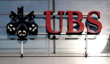 UBS reinstates economist after China pig row