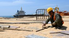 Virus slows China's major projects in Asia