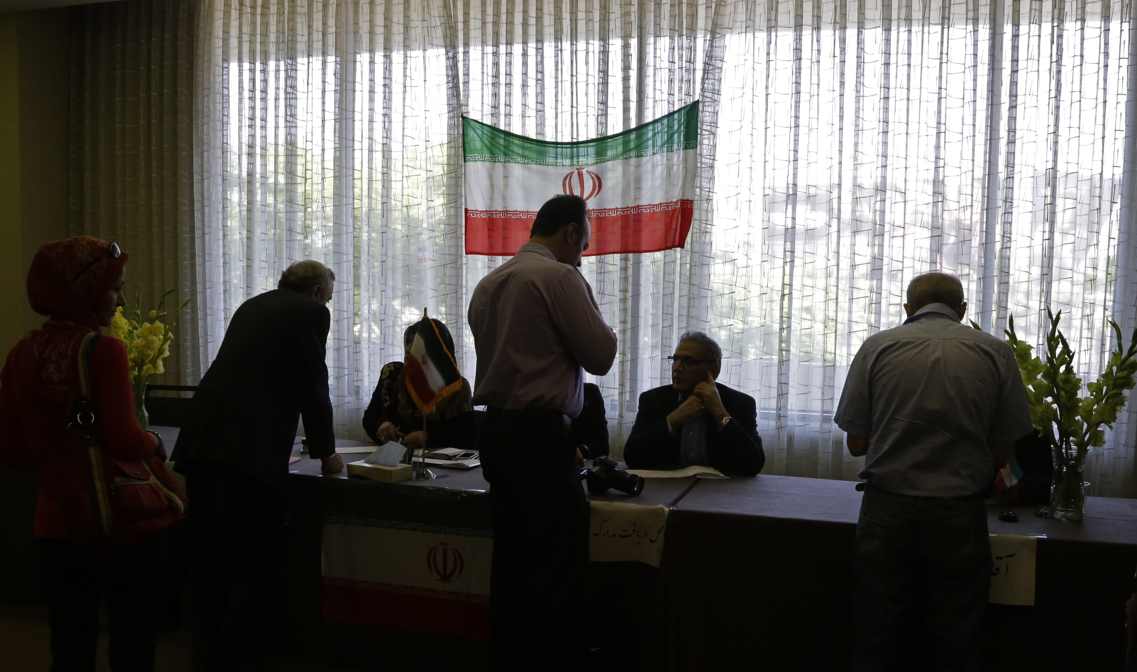 Iranians outside their country of origin sign in to cast ballots in Iran's presidential election, in a hotel meeting room in Los Angeles Friday, June 14, 2013. Iranian-Americans and expatriates cast ballots Friday in polling places across the United States, joining their countrymen half a world away in selecting the next Iranian president (AP Photo/Reed Saxon)
