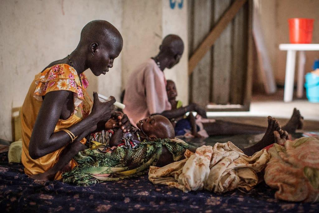Malnourished children receive treatment on July 7, 2014 at the Leer Hospital, run by Medecins Sans Frontieres (AFP Photo/Nichole Sobecki)