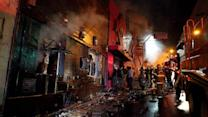 Arrests made in Brazil fire, funerals begin