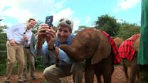 "John Kerry snaps an ""elfie"" with orphan elephant"