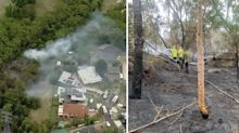 Firefighters working to contain bushfire burning near Sydney homes