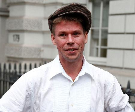 FILE PHOTO: Lauri Love poses for media as he arrives for his extradition hearing at Westminster Magistrates' Court in London, Britain September 16, 2016. REUTERS/Peter Nicholls/File Photo