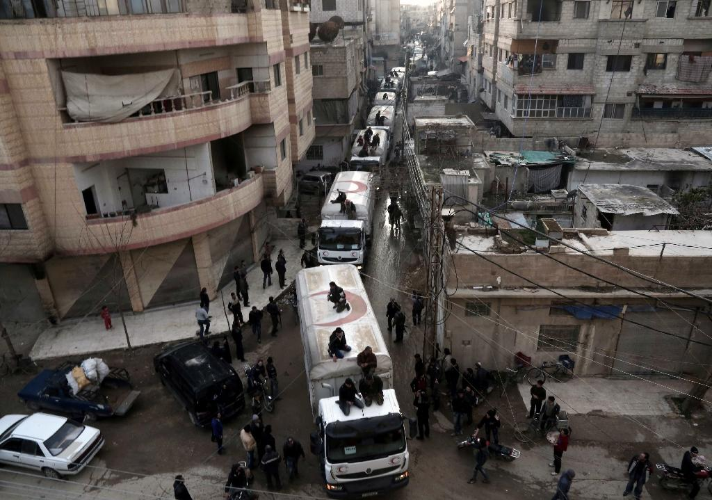 A Red Crescent convoy carrying humanitarian aid arrives in Kafr Batna, in the rebel-held Eastern Ghouta area, on the outskirts of the capital Damascus on February 23, 2016
