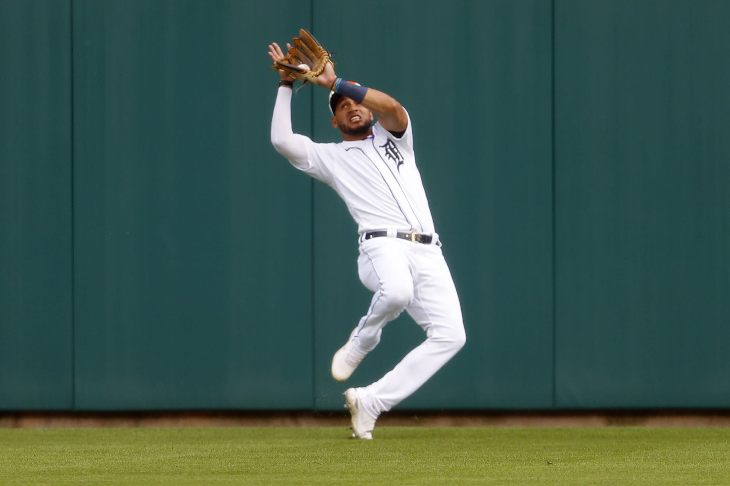 Detroit Tigers center fielder Victor Reyes catches a Cincinnati Reds' Nick Senzel (15) fly ball in the fifth inning of the second baseball game of a doubleheader in Detroit, Sunday, Aug. 2, 2020. (AP Photo/Paul Sancya)