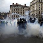 The Latest: Pressure mounting on French leader over protests