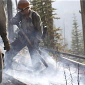 Wildfire blocking Yellowstone entrance smolders on