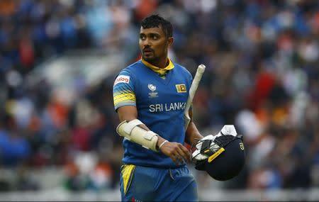 Sri Lanka's Danushka Gunathilaka walks off dejected after being run out