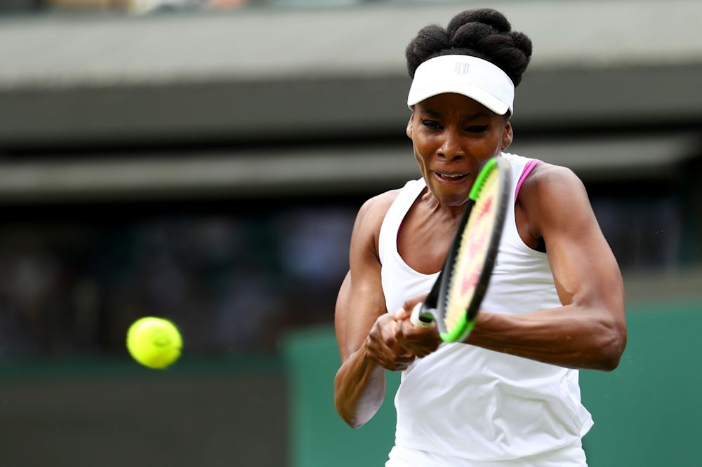 Venus Williams of the United States plays a backhand during the Ladies Singles first round match against Elise Mertens of Belgium on day one of the Wimbledon Lawn Tennis Championships at the All England Lawn Tennis and Croquet Club on July 3, 2017 in London, England.