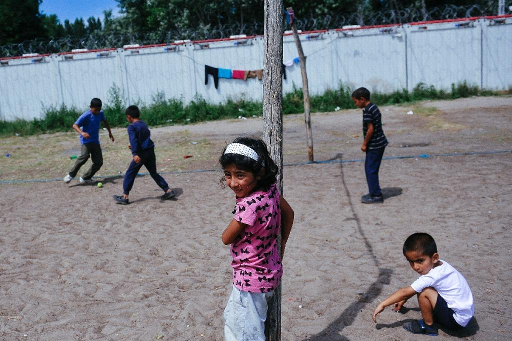 Children play at a migrant camp on the Serbia-Hungary, as migrants wait in hope of being let into Hungary's transit zone to seek asylum (AFP Photo/Alexa Stankovic)