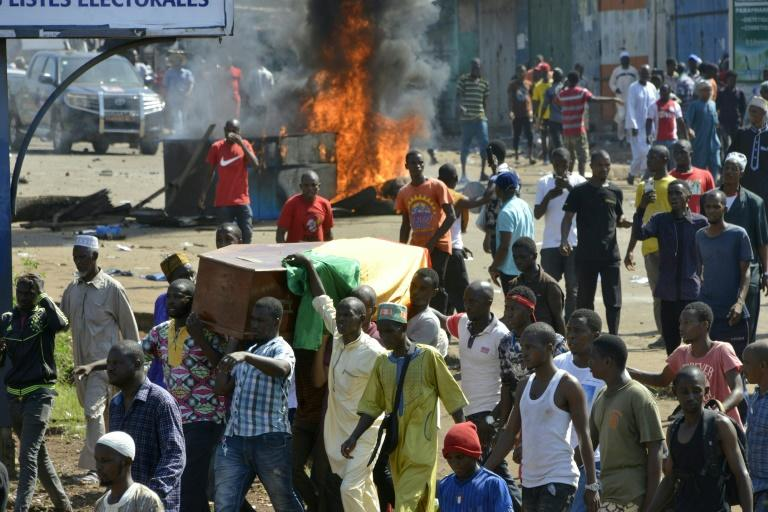 Violence erupted after hundreds marched in the capital Conakry to accompany coffins of people killed in more than a week of demonstrations (AFP Photo/CELLOU BINANI)