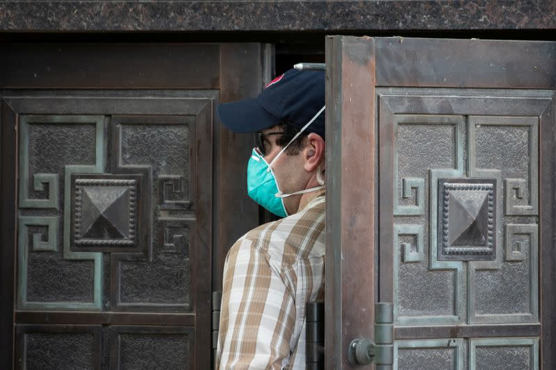 A plain clothes U.S. security official enters the back door of China's Consulate after Chinese employees left the building, in Houston
