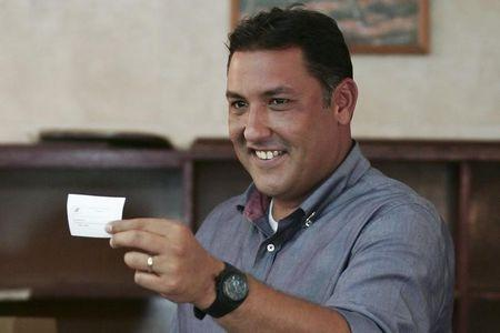 Pablo Perez casts his vote at a polling station in Maracaibo