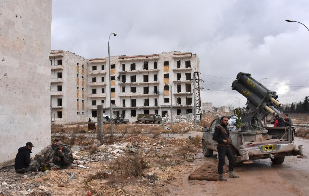 Syrian pro-government forces set up an outpost on December 2, 2016 in the Aleppo's eastern neighbourhood of Sakan al-Shababi after they retook from rebel fighters (AFP Photo/George Ourfalian)