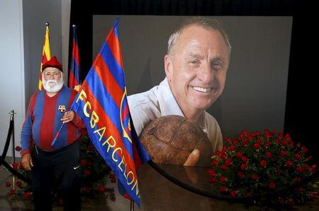 An FC Barcelona supporter poses during a memorial event for Dutch soccer player Johan Cruyff at Camp Nou stadium in Barcelona