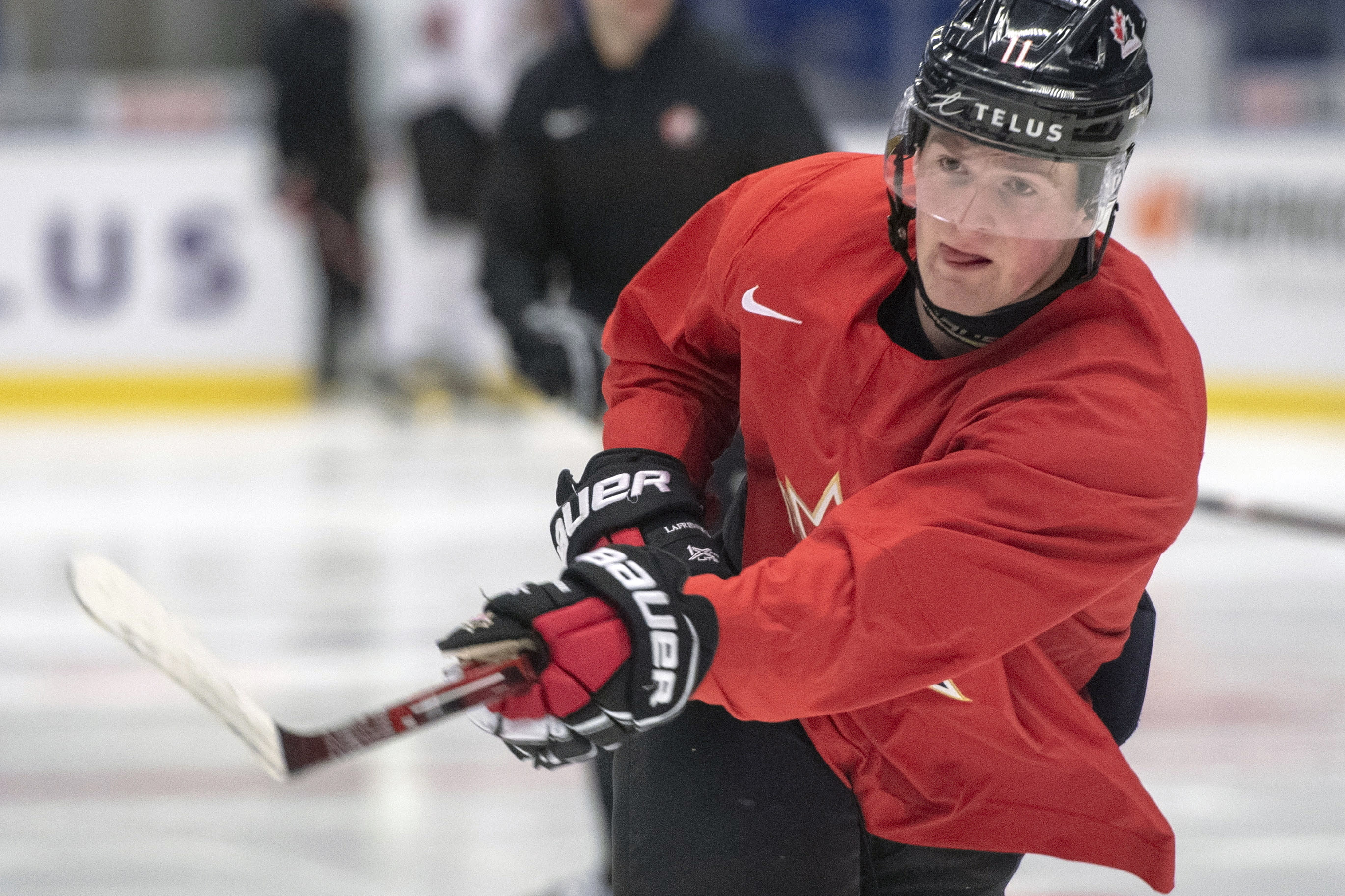 FILE - In this Jan. 1, 2020, file photo, Canada's Alexis Lafreniere shoots during the team's practice at the World Junior Hockey Championships in Ostrava, Czech Republic. The New York Rangers might be on the clock in owning the No. 1 pick in the NHL draft on Tuesday, Oct. 6. That, and the prospect of selecting Quebec star forward Alexis Lafreniere, doesn't mean the still-retooling Rangers will be anywhere closer to being a contender, team president John Davidson cautions. (Ryan Remiorz/The Canadian Press via AP, File)