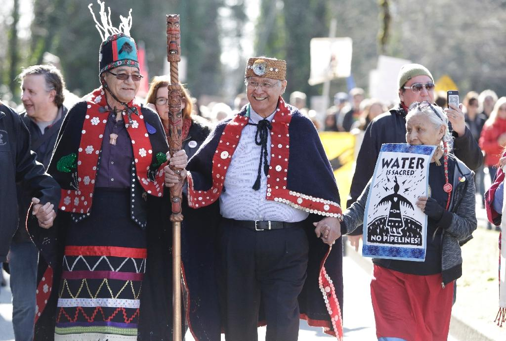 Indigenous leaders participate in a protest against the expansion of Texas-based Kinder Morgan's Trans Mountain pipeline project in Burnaby, British Columbia on March 10, 2018