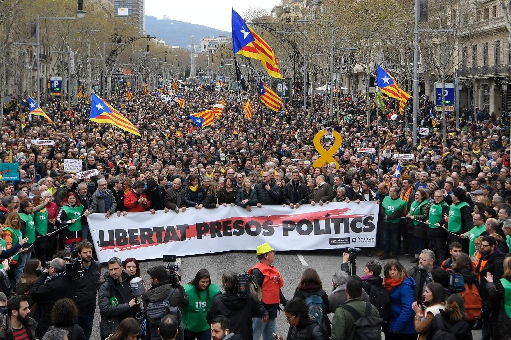 "Protesters held a banner reading ""Freedom to political prisoners"" during a demonstration in Barcelona after Catalonia's former president was arrested in Germany (AFP Photo/LLUIS GENE)"