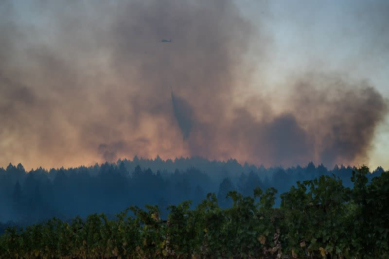 Helicopter drops water over the Glass Fire in Calistoga, California