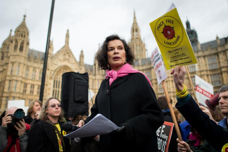 Activist Bianca Jagger addresses an anti-fracking rally outside the Houses of Parliament in central London on January 26, 2015 (AFP Photo/Leon Neal)